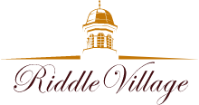 Riddle Village Logo